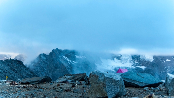 A pink tent against the backdrop of the Parvati South peak