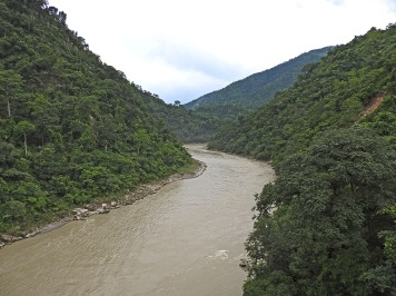 A monsoon-swoolen Teesta emerges from the mountains