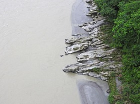 Rocks dip their toes in the Teesta