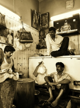 "Butchers take a break from the slaughter""INA Market, New Delhi"