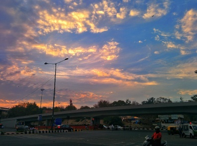 Even the usually cacophonous Kalkaji crossing was tamed by the skies above